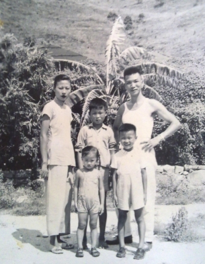My dad in the middle, with his family in Hong Kong circa 1951.