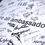 The signed We Are All Ambassadors poster.