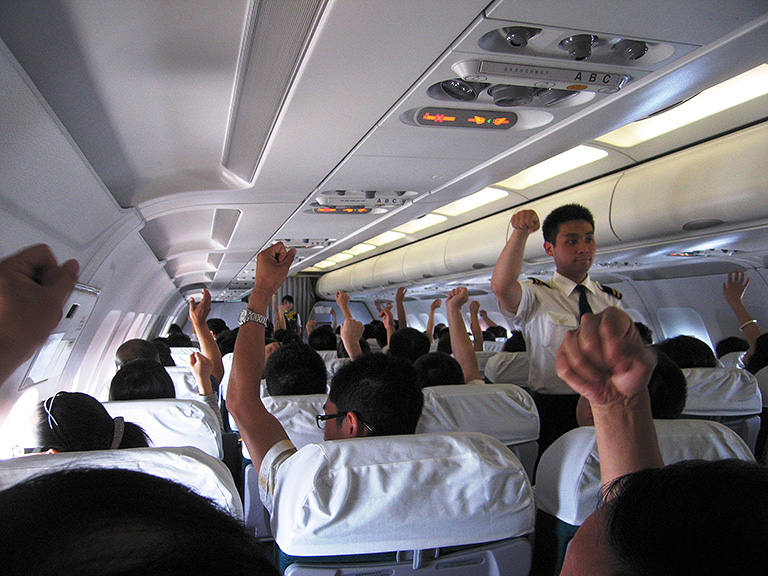 Stretching exercises on the flight.