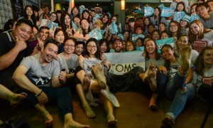 TOMS founder Blake Mycoskie  poses with new Pengyous.