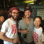 Project Pengyou interns Nate Levin and Kim Chen pose with TOMS founder Blake Mycoskie.