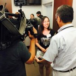 Mingqing Wang, on the Harvard Chapter leadership team, is interviewed by media following the event.