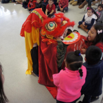 SIS brings a Lion Dance to their community!