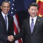 PARIS, Nov. 30, 2015-- Chinese President Xi Jinping, right, meets with his U.S. counterpart Barack Obama in Paris, France, Nov. 30, 2015. (Xinhua/Lan Hongguang via Getty Images)