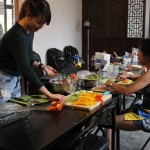 Project Pengyou Interns, new and old, help prepare the July 4th feast