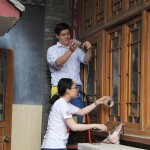 Project Pengyou Interns, David and Xin, decorate the courtyard