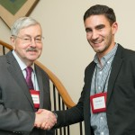 Ambassador Branstad greets China Studies Institute scholar Trevor Brown.