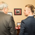 Project Pengyou Intern Alexander Mitu listening intently to Ambassador Branstad share his history with China.
