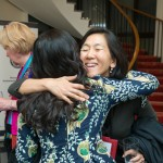 Golden Bridges Founder Holly Chang and Foreign Service Officer Nancy Chen share a hug.