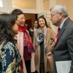 Holly Chang, Founder of Project Pengyou/Golden Bridges, and Mei Yan, Golden Bridges Vice Chair of the Board, greet Ambassador Branstad.