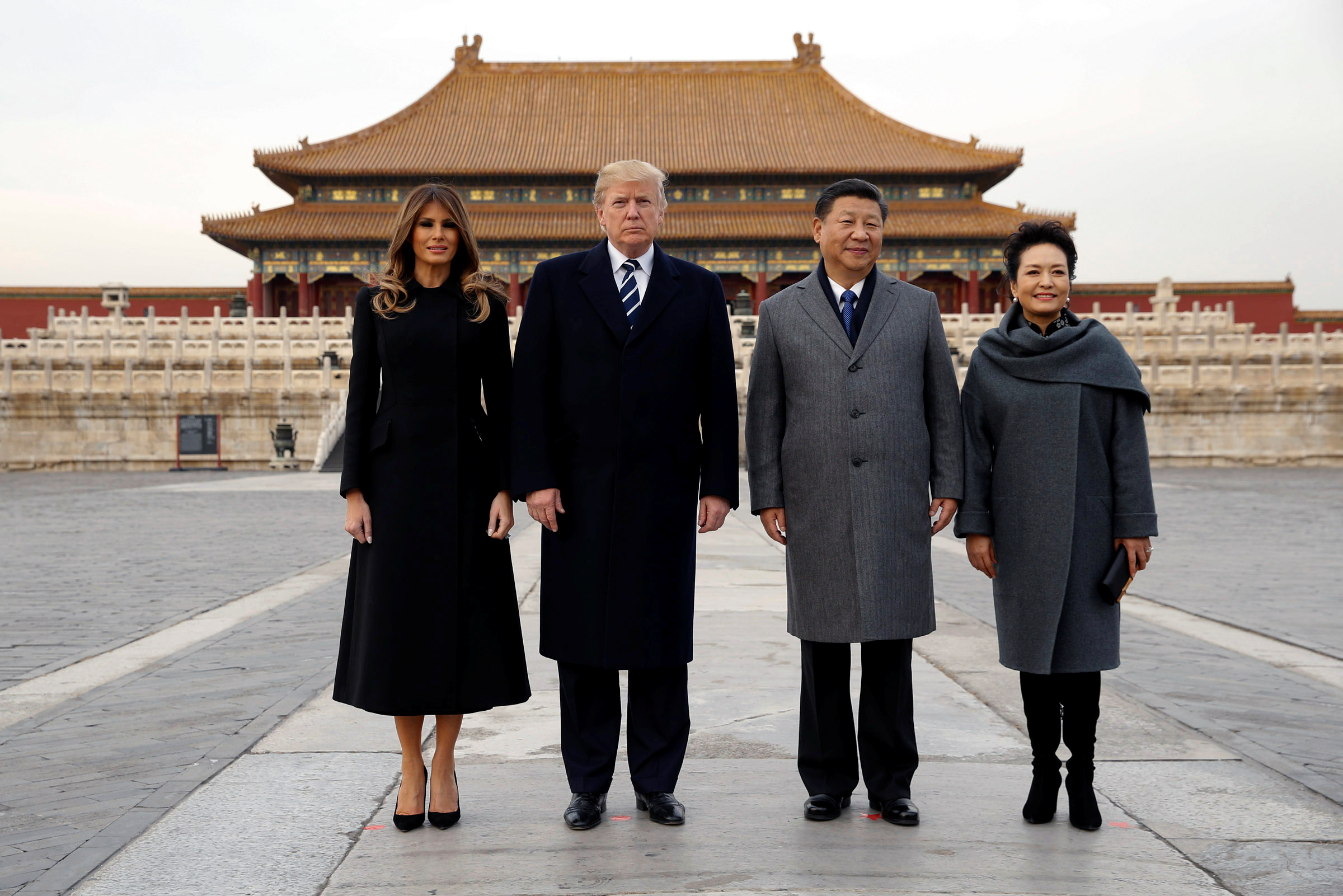 U.S. President Donald Trump and U.S. first lady Melania visit the Forbidden City with China's President Xi Jinping and China's First Lady Peng Liyuan in Beijing, China, November 8, 2017. REUTERS/Jonathan Ernst - RC13C8D168D0