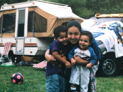 Me, my older brother, and my mom on a camping trip (I'm the cute one to the right).